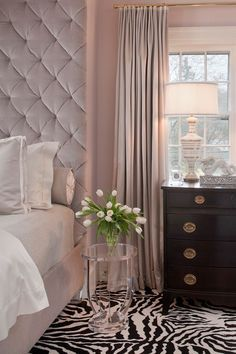 Suzie: Tiffany Eastman Interiors - Blush pink bedroom with blush pink walls paint color, blush pink velvet tufted tall headboard bed, blush pink bedding, ...