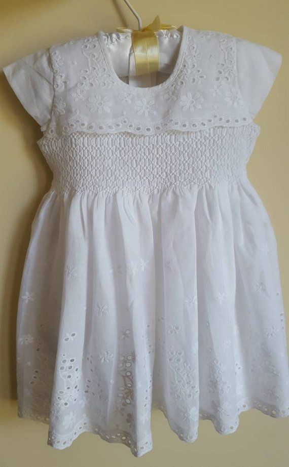 650eadb3d63f Baby girls white smocked dress made from beautiful cotton embroidered  fabric.The dress is fully lined with a matching white soft cotton.