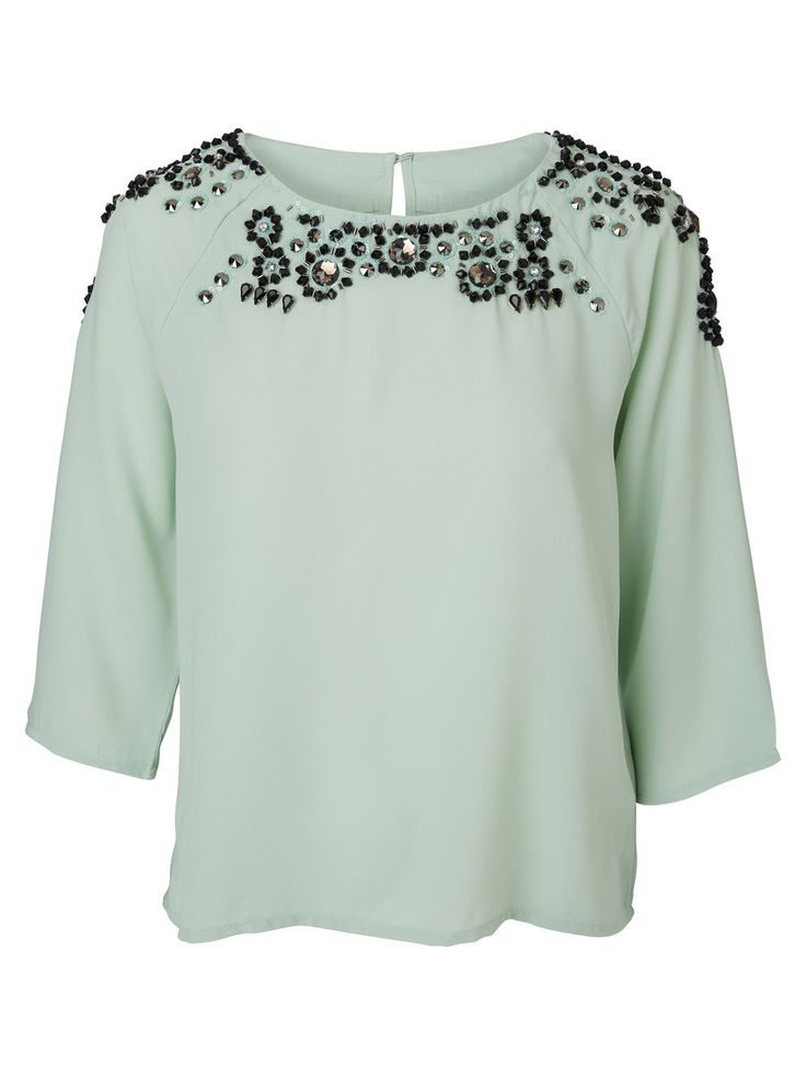 Embellished top from VERO MODA. This top is perfect for your next party look. Style tip: Keep the accessorizing to a minimum - the top does it all for you.
