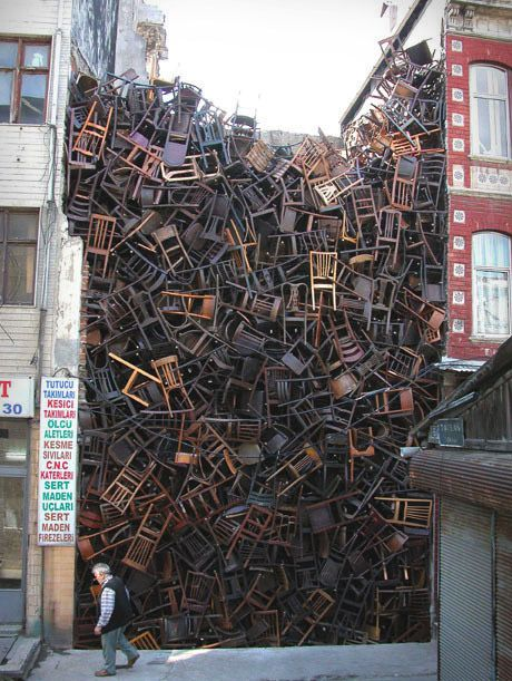 1550 Chairs Stacked Between Two City Buildings. An installation by Doris Salcedo at the 2003 Istanbul Biennial.