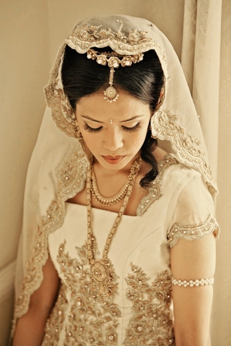 East Meets West Wedding Gowns – White Lenghas, Saris, Dresses. I love this detail and how the headpiece matches