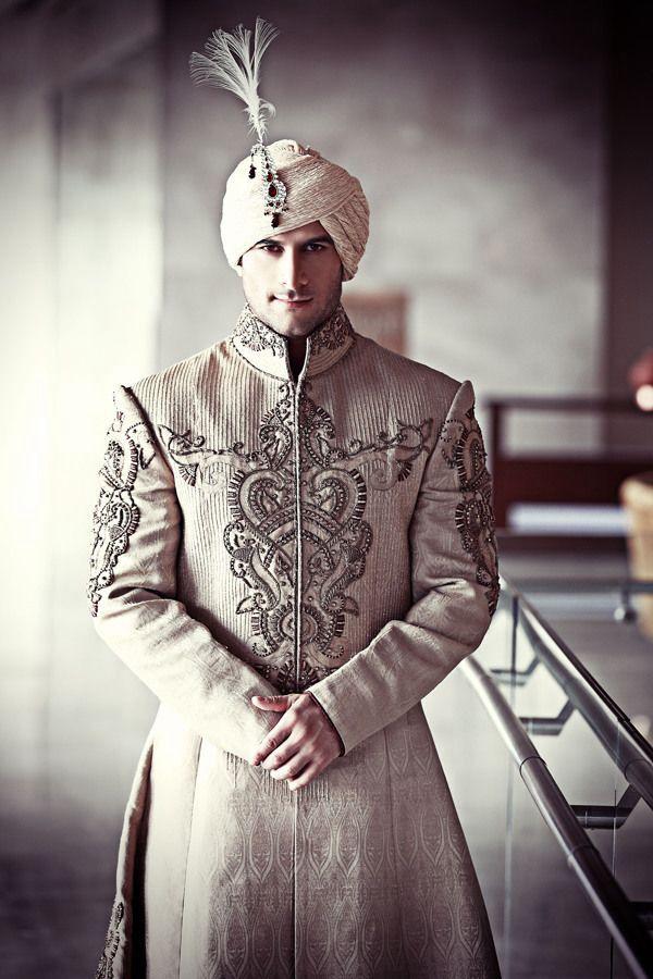 Indian groom wearing sherwani and turban. Groom wear