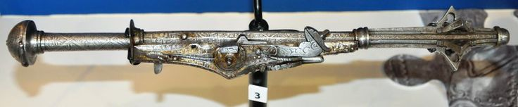A wheellock mace/gun combo originating from Germany, circa 1560. Currently on display at the Tower of London.