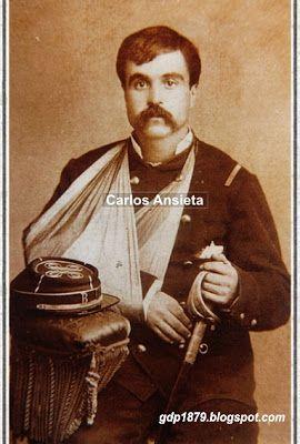 Carlos Luis Ansieta Varela, nació en Vicuña, hijo de don José Santiago Ansieta y de doña Teodosia Varela. Ingresó como soldado en 1879 en el batallón Nº 1 Coquimbo, en la 3ª compañía de dicho batallón, ascendiendo a cabo 1°, sargento 2° y luego subteniente Abanderado, desde abril de 1880. Participó en la toma de Pisagua, Batalla de Dolores, Tacna, San Juan y Miraflores. En Tacna recibió dos heridas en el brazo derecho defendiendo el estandarte. La fotografía lo muestra herido por esa…