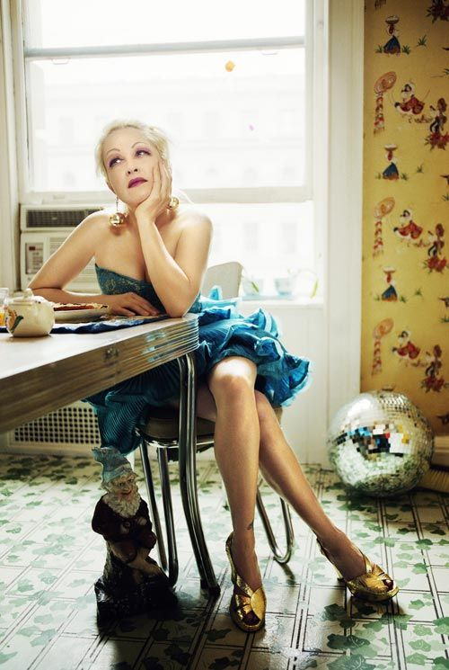 Cyndi Lauper at the kitchen table (I remember more photos taken in her kitchen a few years ago; still loving the wallpaper!)