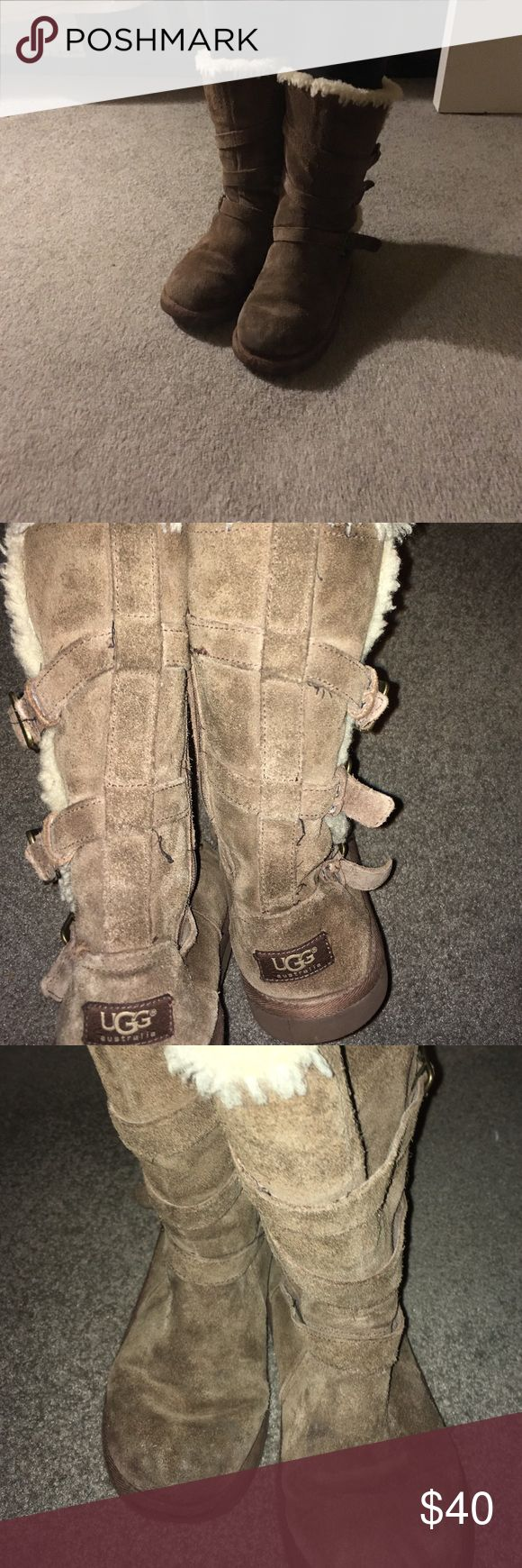 """Some good ol' Maddie Uggs! Size 4(girls) 6.5(W) Maggie Style Girls Uggs, marked Size 4. It fits me kind of big, and I Wear a 6- 6.5. So I would say fits a 7- 71/2 very well.  These are Taupe Suede and 3 buckles on outer boot with a zipper on the inside part  boot.  These are authentic and are great for keeping toes warm and dry.  The sole is approximately 10 1/4"""". Any questions please ask. These are broken in and that is reflected in the price. The fur lining on the inside of the sole is…"""