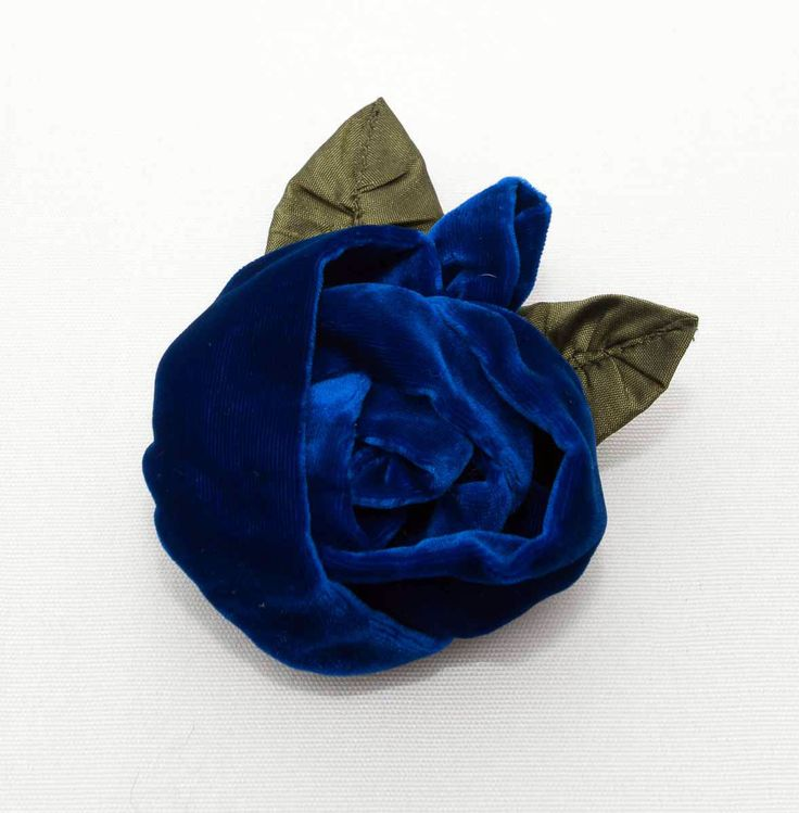 Treat yourself or surprise a good friend with a lovely gift of this beautiful cobalt blue handmade velvet rosebud and leaf brooch by New Zealand designer Tamsin Cooper. This best selling velvet rose brooch is beautifully handmade with a large layered rose and small side rosebud made from luxurious velvet petals and 100% silk taffeta leaves. The size is approximately 9cm x 9cm but each rose brooch is unique. More colours from Gorgeous Creatures.
