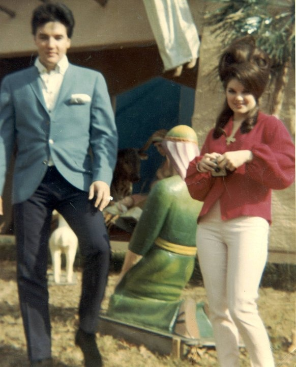 Elvis and Priscilla at Graceland, with life-size nativity scene behind them.  Early/Mid sixties.