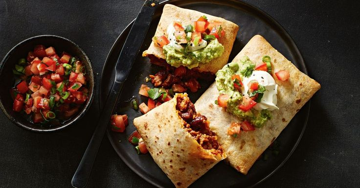 Feel free to ditch your cutlery as you dive into these Mexican beef chimichangas. Beans, guacamole and sour cream will definitely light up your day.
