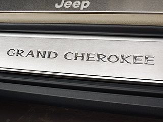 Jeep Grand Cherokee Stainless steel Door Entry Guards Grand Cherokee logo on fronts only. Complete set of four. For Jeep Grand Cherokee 2011 - 2012. Authentic Mopar Accessory.