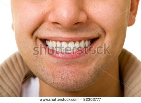 smile of the young men are very close. Teeth