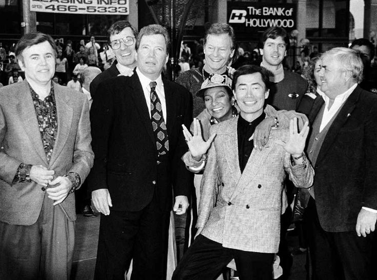 Captain & Crew from Leonard Nimoy's Life in Photos.  Takei has to ham it up like the gayboi he is.