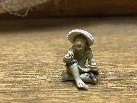 Tiny Mudman Figurine Sitting with Hat – perfect for house plants, fairy gardens and bonsai - The Bonsai Tool & Supply Company of Canada