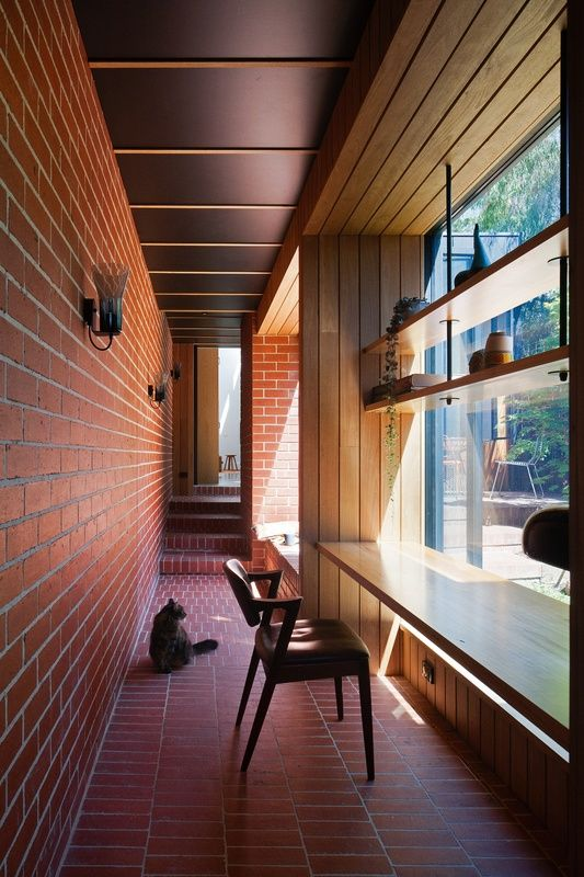 With a compelling ten-metre-long, red brick hallway that offers far more than…