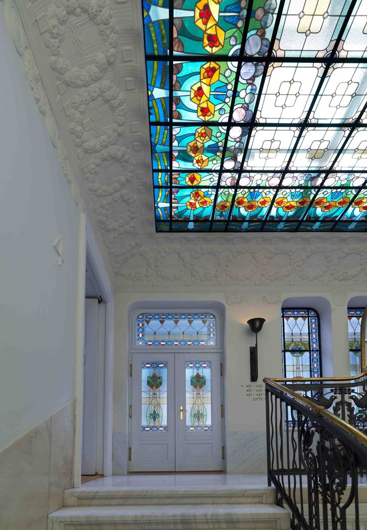 Beautifully crafted stained glass window at the staircase of the four seasons hotel gresham palace budapest