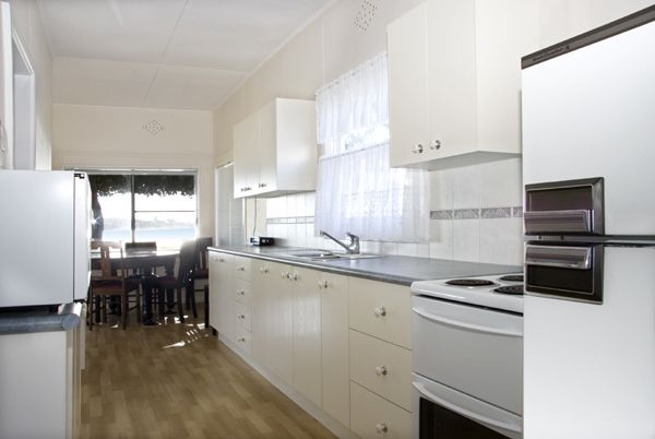 Footsteps to the Beach-kitchen shot call 9527-7733 to book or bundeenarealestate.com.au