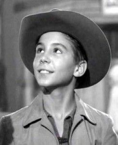Johnny Crawford playing the role of Mark McCain on the ABC western series THE RIFLEMAN.