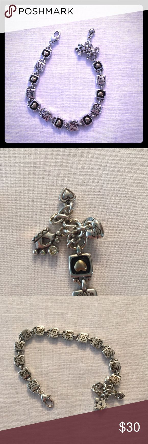Brighton Paver Bracelet with Charms For sale today we have a Brighton Paver Bracelet with charms. In good condition. Charms are of a crown with rhinestone, ladybug with two rhinestones, a heart and a Brighton heart. Brighton Jewelry Bracelets