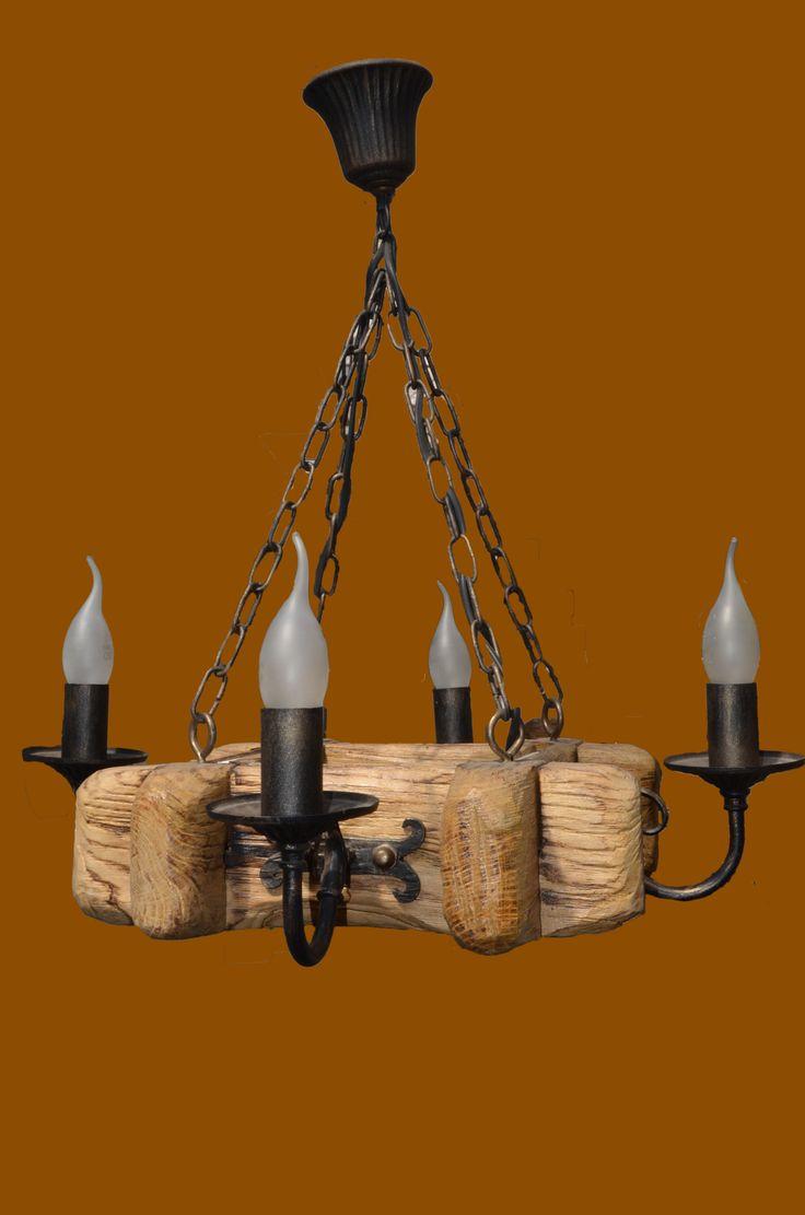Модель: Кованая люстра ISFIR рамка (726) Описание Кованая люстра ISFIR 726 (4 свечи)  Кованая люстра ISFIR рамка сделана из качественного дерева дуба и из металлических свечей которые гармонично дополняют элегантность люстры. Она хорошо подходит под любой стиль. Заказать Кованую люстру ISFIR рамка (4 свечи) Вы можете с помощью нашего интернет - супермаркета Mol.com.ua!