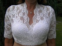 Dirndl blouse size M, made of elastic lace in white