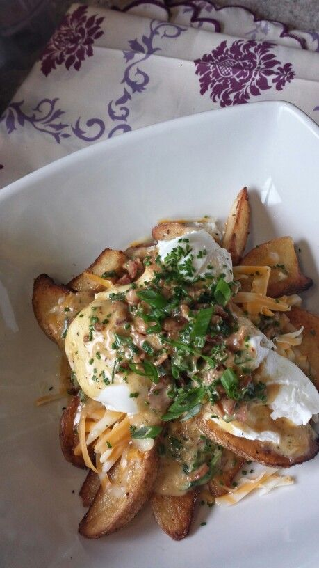 Wedge potatoe eggs benny poutine with bacon mustard hollandaise,  cheddar cheese and truffle oil