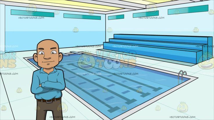 a bald guy standing with his arms crossed over his chest at indoor olympic size swimming pool