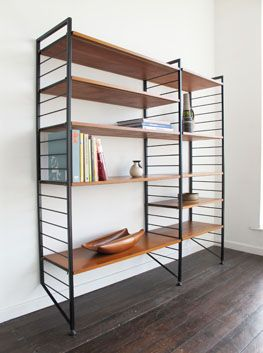 'Lean back' adjustable shelving