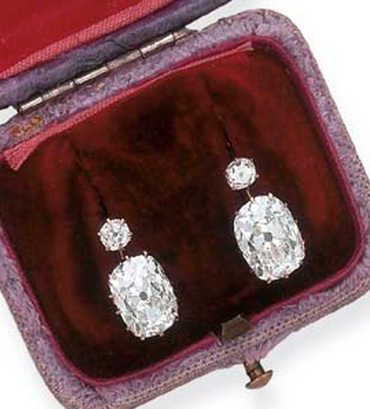 A PAIR OF ANTIQUE DIAMOND EAR PENDANTS Each suspending a cushion-cut diamond, weighing approximately 3.75 and 4.35 carats, to the old European-cut diamond surmount, mounted in gold, circa 1890, in a gray fabric fitted case