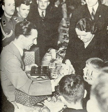 Dr. Joseph Goebbels gives gifts to the children of German workers, for Christmas in 1938. (via indesirableprincesse)
