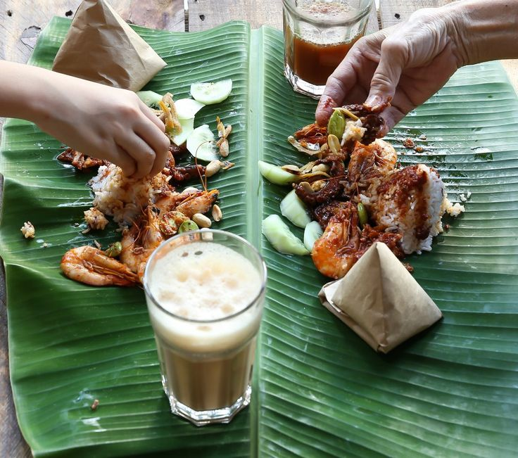 Nasi Lemak, a favourite Malaysian meal served with teh tarik (froth teh)