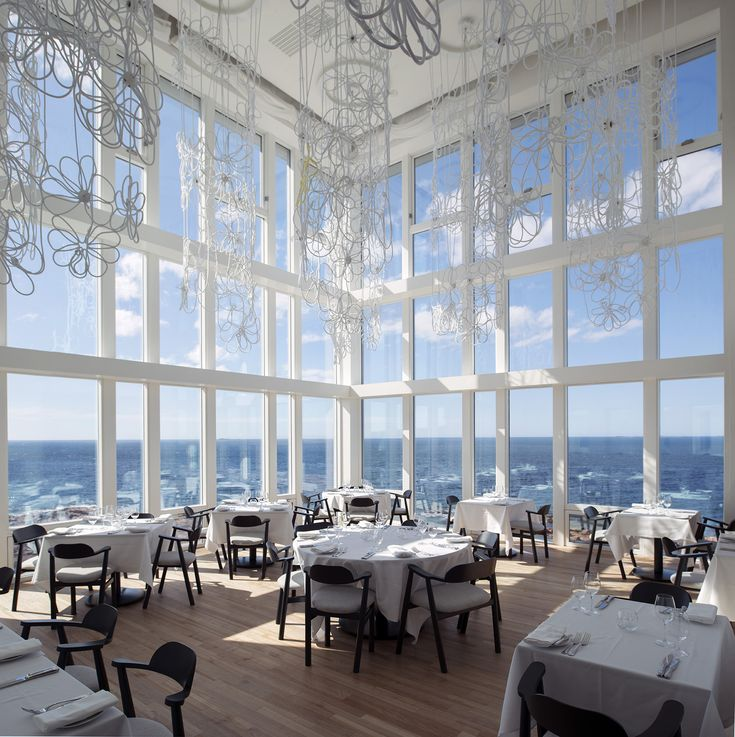 Spectacular views of the wild north Atlantic from  our award-winning dining room with floor-to-ceiling windows.  #Newfoundland #FogoIsland #IslandLife
