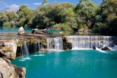 Manavgat Waterfall, Turkey Manavgat Waterfall on the Manavgat River is near the city of Side, 3 km north of Manavgat, Turkey. Its high flow over a wide area as it falls from a low height is best viewed from a high altitude.
