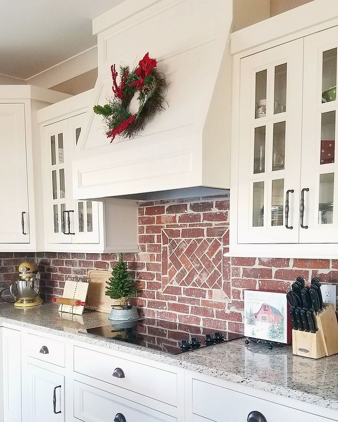 White Kitchen With Brick Backsplash The Shaker Style Cabinets Are