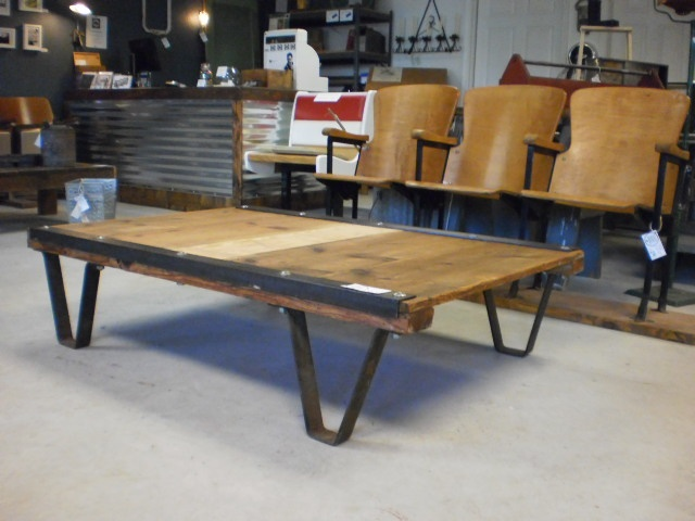 1930's rail road pallet repurposed into a modern coffee table, w/antique theater seats.  www.eco7tradingco.com