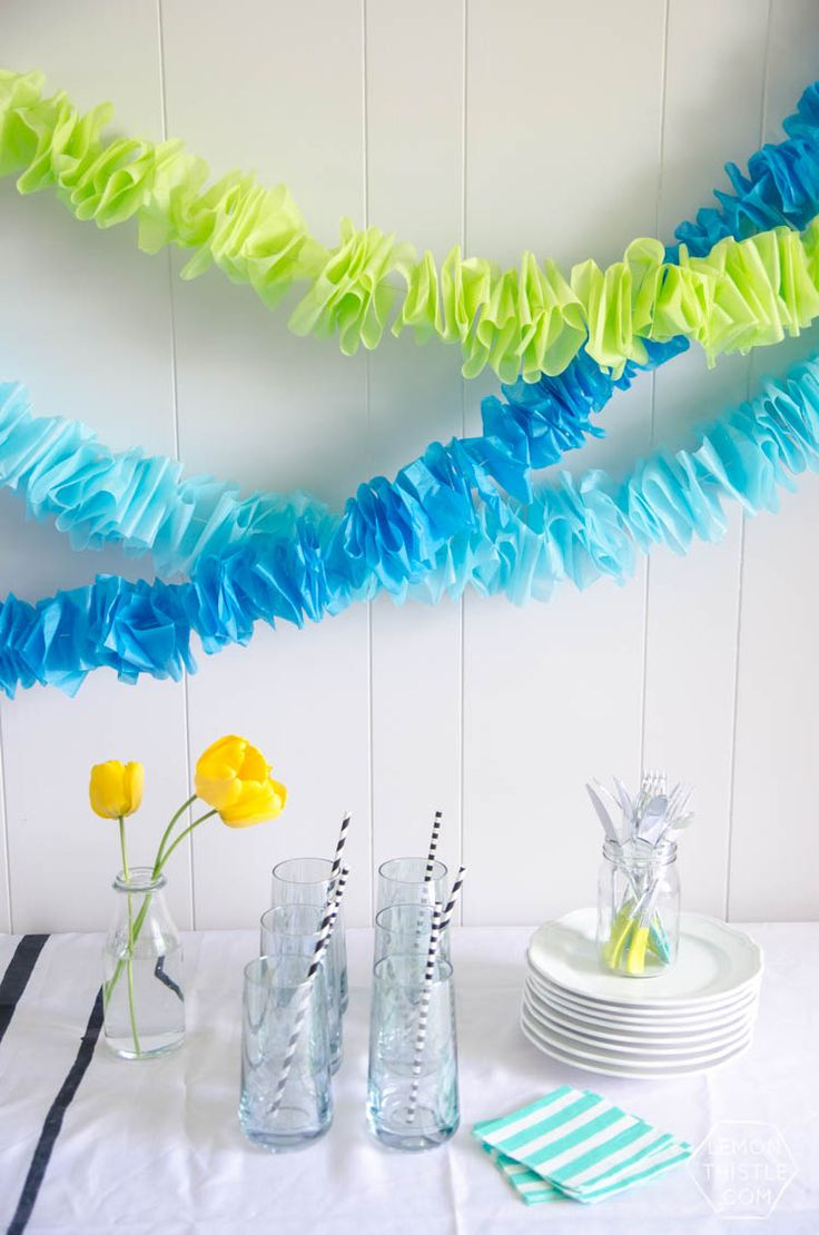 FEATURED! This DIY Ruffled Tissue Garland is seriously simple and costs next to nothing. Change up the colours to match almost any party theme out there!