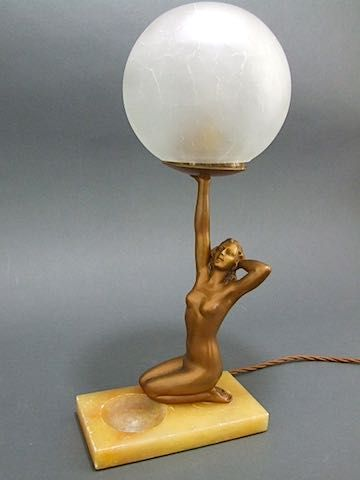 Art deco nude figurative man lifting woman lamp