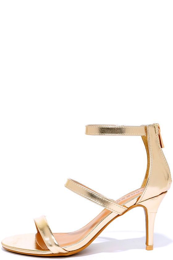 With a lower heel height, the Three-for-All Gold Kitten Heels are as sensible as they are glamorous! Three vegan leather straps compose an open-toe upper with zippered heel cup.
