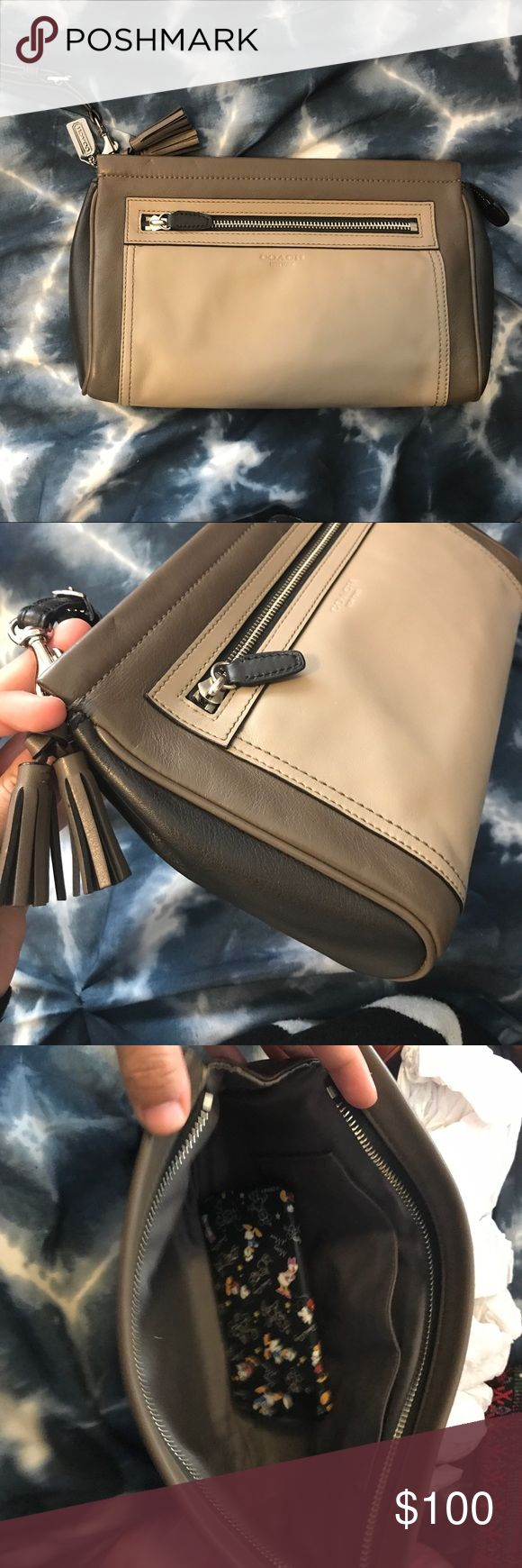 Coach legacy large clutch This is a large clutch from coach legacy collection. It's 3 colors. Black, dark taupe, and light taupe. In in like new cond. last picture shows an iPhone 7 case inside for size reference. It holds a lot. Coach Bags Clutches & Wristlets