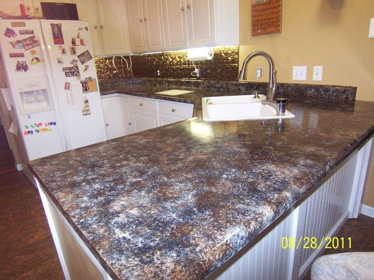 ... Kitchen backsplash, Cabinet drawers and Faux granite countertops