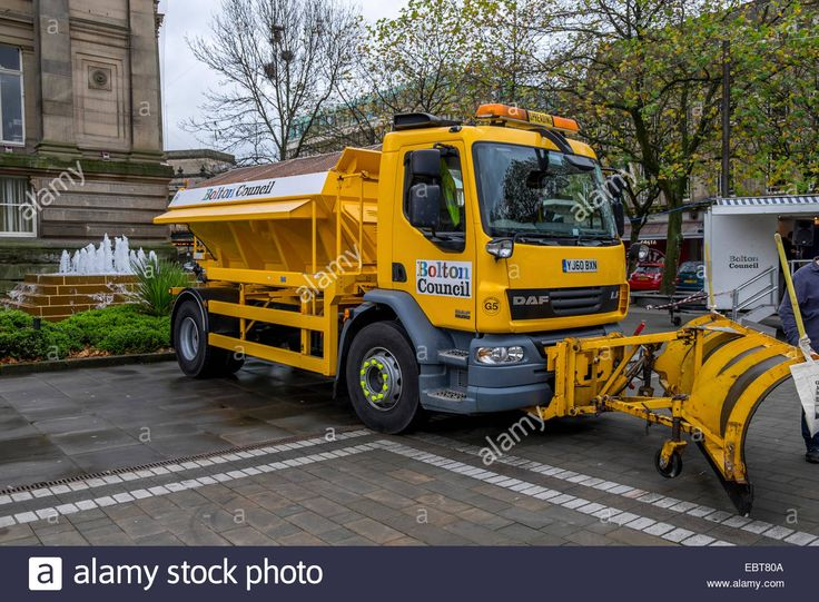 A Large Vehicle Used For Spreading Salt Grit In The Winter