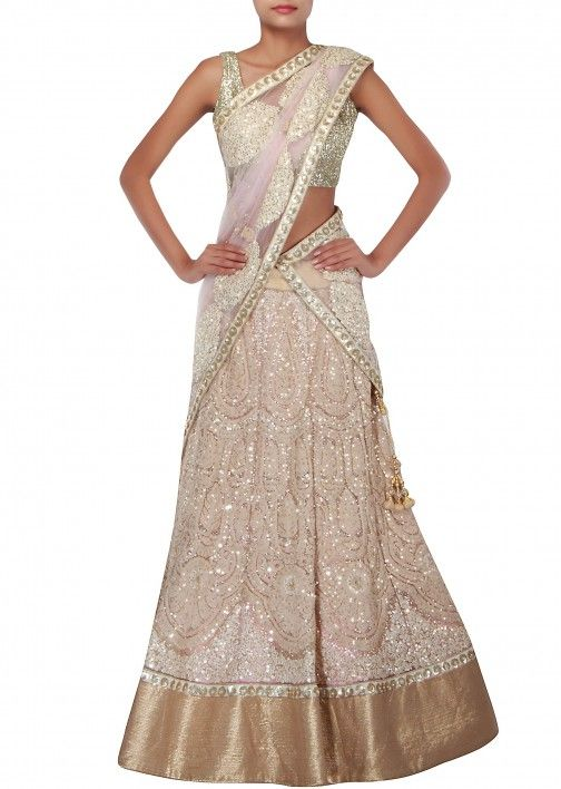 Light beige lehenga features with embossed thread embroidery only on Kalki