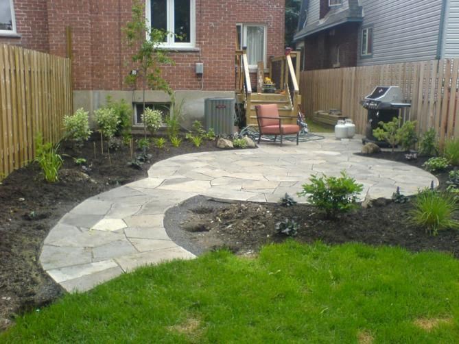 Round flag stone patio outdoor inspiration pinterest for Flagstone patio designs
