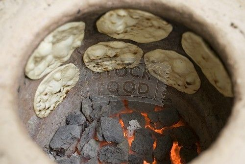 BAKING IN A TRADITIONAL TANDOORI OVEN | good video on how to make Naan . It seems that the traditional ...