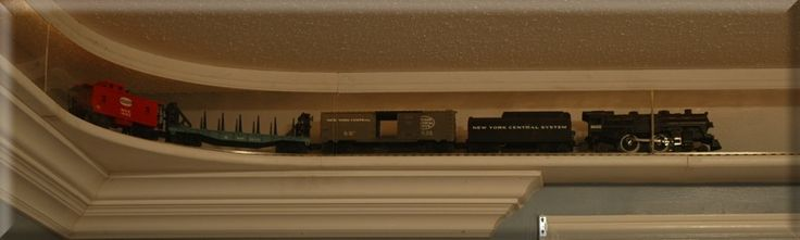 oh my very goodness i've always wanted this for my dream house, to have a train going around the room