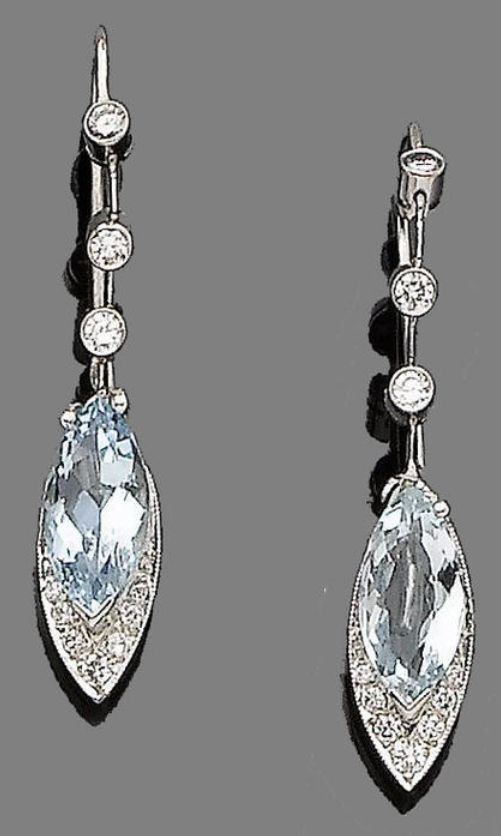 A pair of aquamarine and diamond pendent earrings  Each navette-shaped drop set with a marquise-cut aquamarine and brilliant-cut diamond highlights, to a collet-set similarly-cut diamond articulated surmount, diamonds approx. 0.40ct total, length 4.0cm