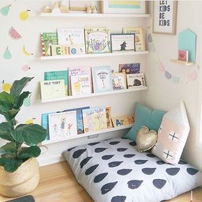 Some pillows and simple shelving are all it takes to create a fantastic reading nook. #simplekidsroomideas