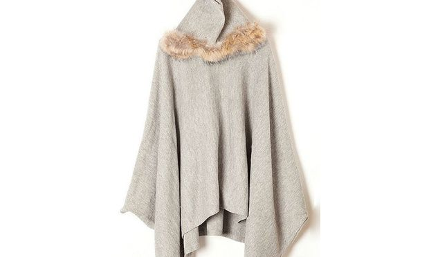 Bundle up in a cosy batwing coat that features a faux fur trim and relaxed fit; throw over a light jumper and a pair of jeans to keep warm