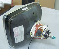 A 14 inch cathode ray tube showing its deflection coils and electron guns