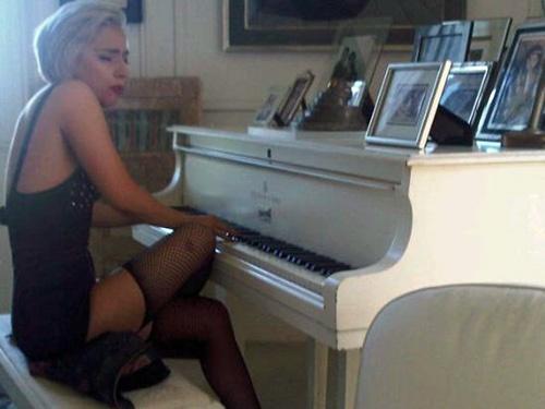 Lady Gaga at John Lennon's white Steinway grand piano.