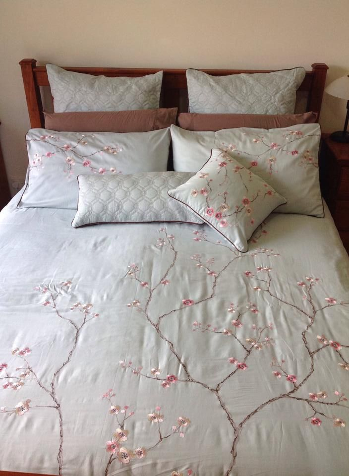 Botanica on bed. Get yours at www.lorrainelea.com